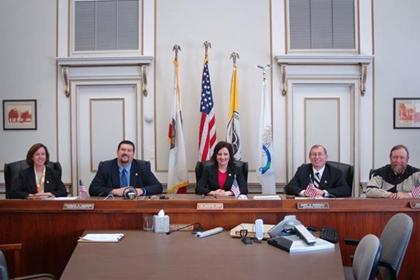 Board of Supervisors sitting at the desk