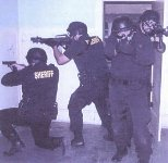 SOAR team members searching a room